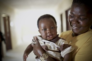Ansu, 3 months old, and his mother Emily at the Save the Children